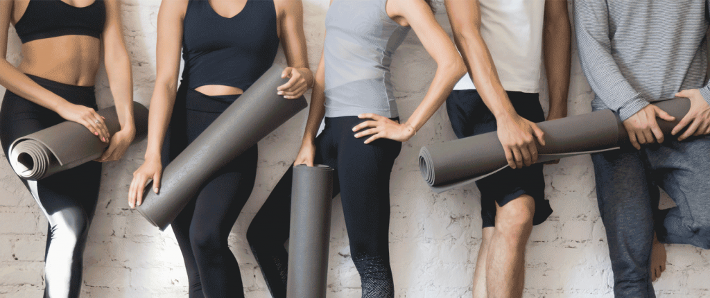 students with yoga mats